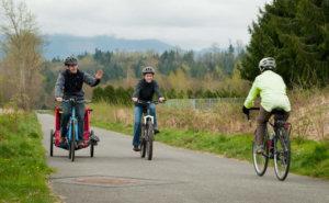 cyclists on a paved trail